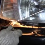 Как снять переднюю фару на рено логан