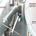 Регулировка стояночного тормоза («ручника» ) Рено Логан 1,4 |